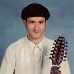 Rick Lupert in a beret - with guitar.