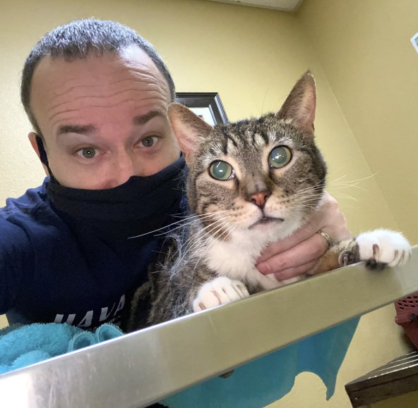 Rick Lupert and his Cat Bootsy at the vet.